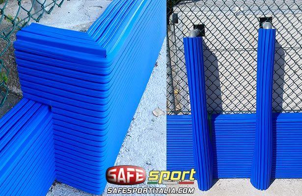 Protezioni gomma antiurto su tubi e muretto di cemento